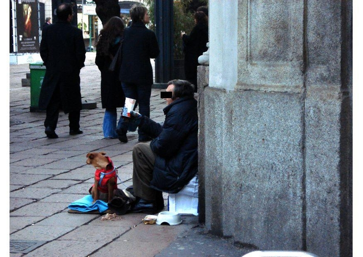 Photo beggar in Milan