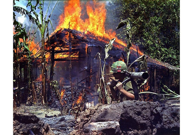 Photo burning Vietcong basecamp