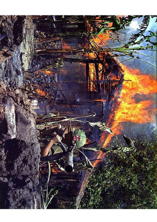 burning Vietcong basecamp