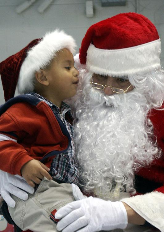 child with Santa Claus