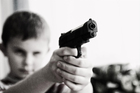 Photos child with weapon