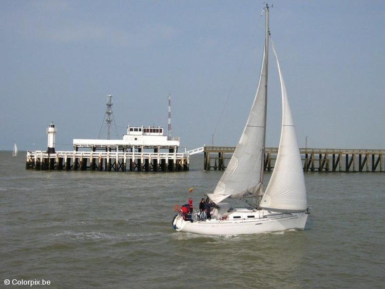 Photo pier with sailing boat