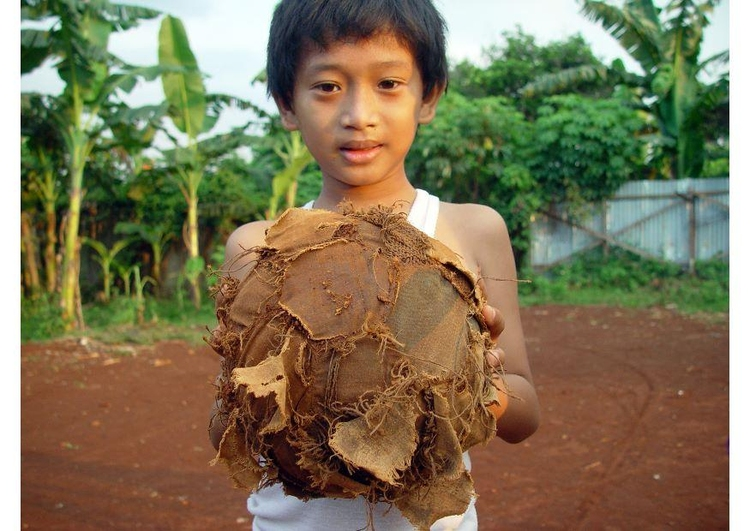 Photo soccer - a tattered football