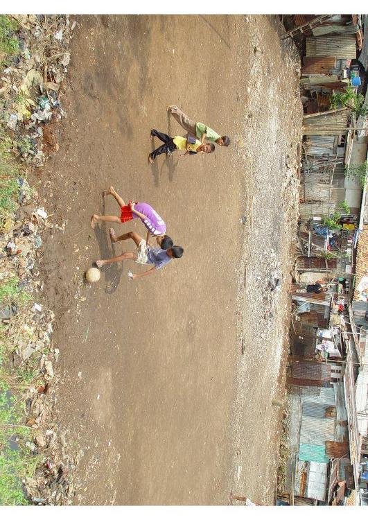 playing soccer (slums)