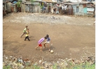 Photo playing soccer (slums)