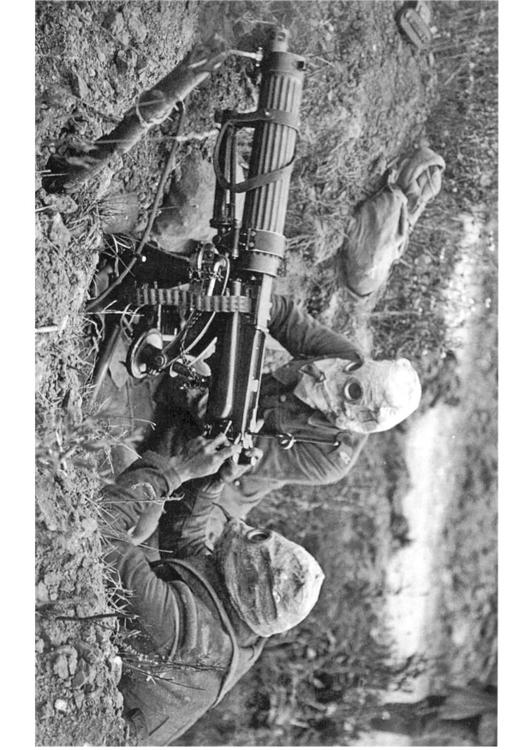 soldier with machine gun and gasmask