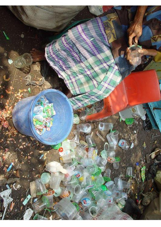 sorting through waste, slums in Jakarta