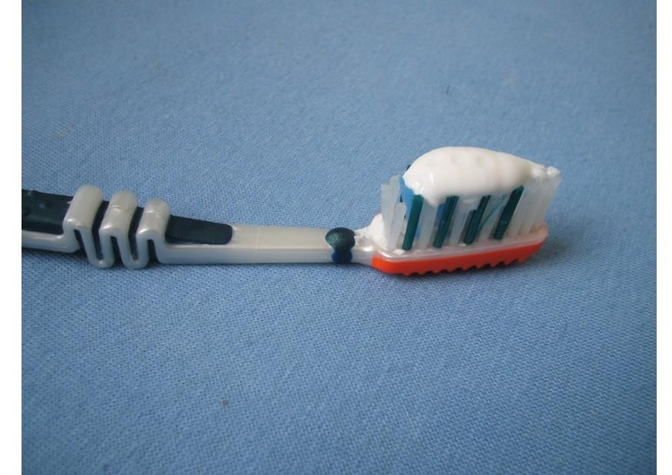 Photo toothbrush with toothpaste