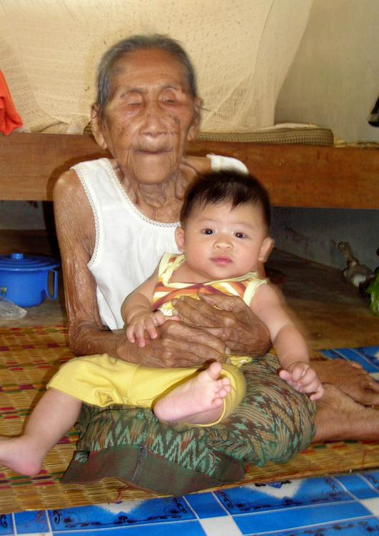 young and old, old woman with baby